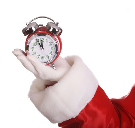 time of the year: Alarm clock on palm of Santa Claus.