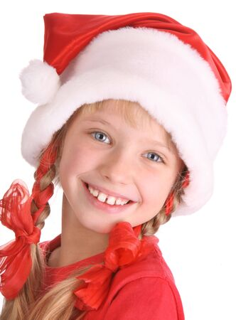 Smiling girl in hat of santa claus. photo