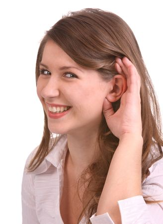 A girl in white blouse listen.  Isolated. Stock Photo - 4002899
