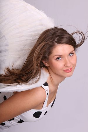 Pretty woman in costume of angel. Stock Photo - 4002905