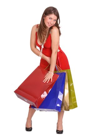 Woman in red dress with gift bag. Isolated. photo