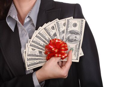 Money in female hands and red bow. Isolated. photo