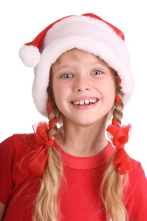 Smiling girl in hat of santa claus. Isolated. photo