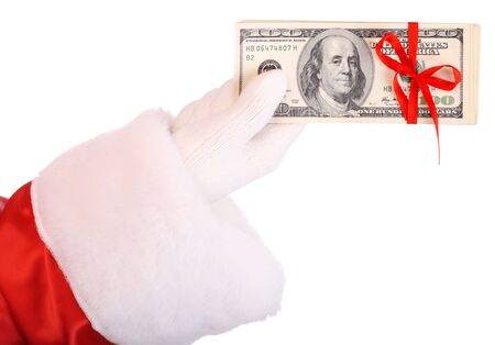 Money in hand of santa claus.  Isolated. photo
