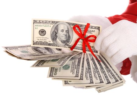 mano con dinero: Dinero en la mano de Santa Claus. Aislados. Foto de archivo