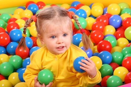 Birthday of smiling girl. Group of color ball backgrounds. photo