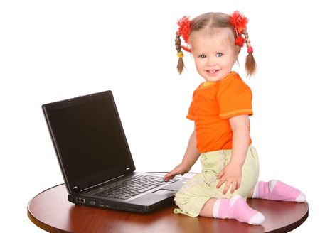 Smiling baby with laptop. Isolated. photo