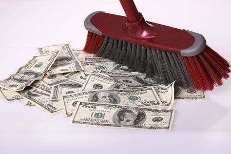 Broom clean dollars on floor. Concept photo