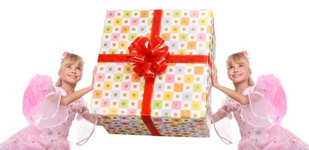 Couple of angel with pink wings and  gift box decorate red bow. Stock Photo - 4162021