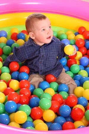Birthday of fun boy in color balls. photo