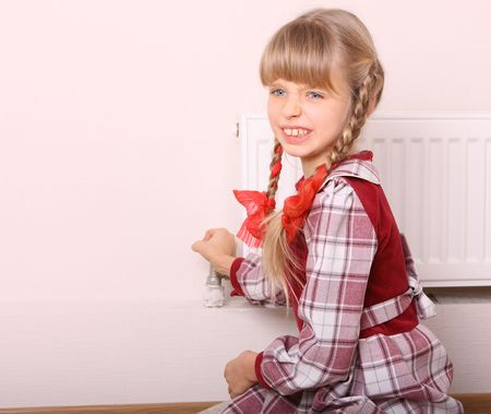 Girl try open thermostat. Energy crisis. photo