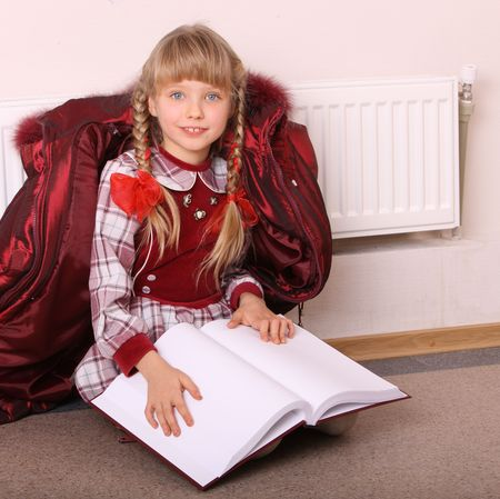 Girl lie near radiator with book. Cold crisis. Stock Photo - 4162022