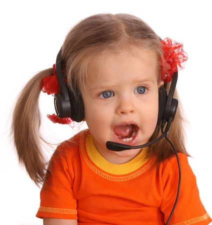 Portrait of child with headset. White background.  photo