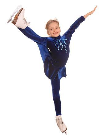 Little girl in blue dress on skates.  photo