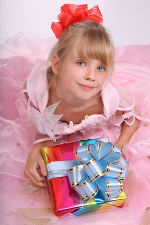 Girl with gift box and blue bow. photo