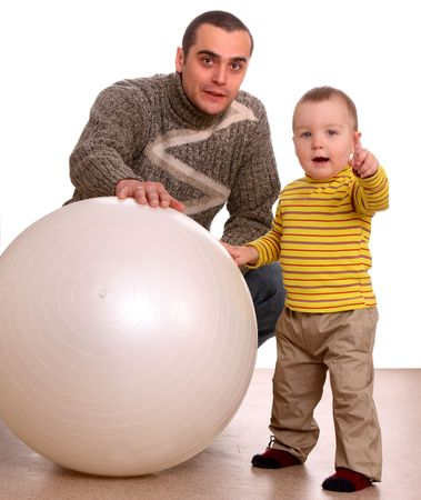 Father and son with fitness ball. Family. photo