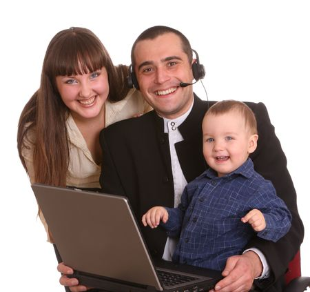 Happy family with laptop and headset. Isolated. photo