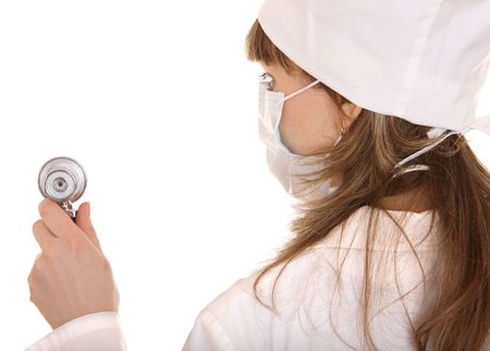 Doctor with stethoscope and mask. Isolated. photo
