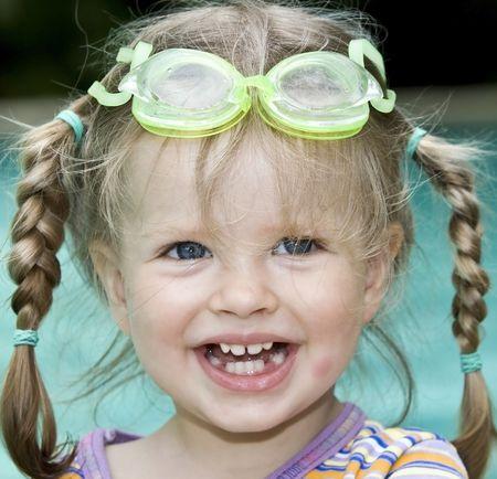 Baby in protective goggles swim pool. Stock Photo - 4878575