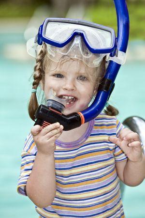 snorkle:  Child learn to swim . Swimming pool.