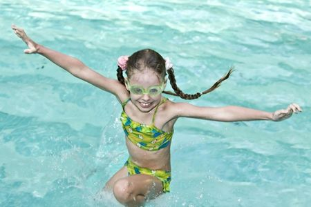 Girl in goggles learn swiml. Swimming pool. Stock Photo - 4878573