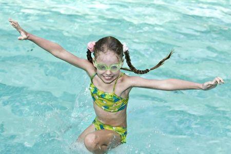 Girl in goggles learn swiml. Swimming pool. Stock Photo - 4878573
