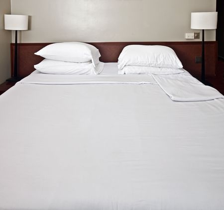 Luxury bedroom with white bedding.Have rest. Stock Photo - 4878643