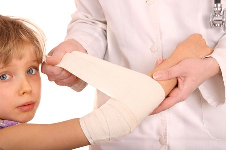 Doctor give first aid of child. Isolated. Stock Photo
