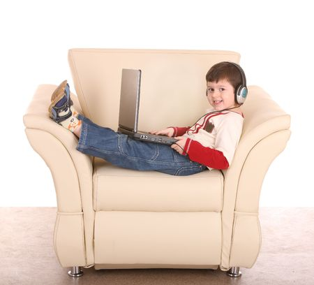 Boy with laptop and headphone. Isolated. Imagens