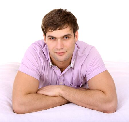 Attractive man on white sheet. Isolated. photo