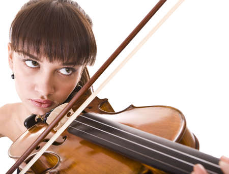 Aggressive young girl with fiddle. Isolated. photo