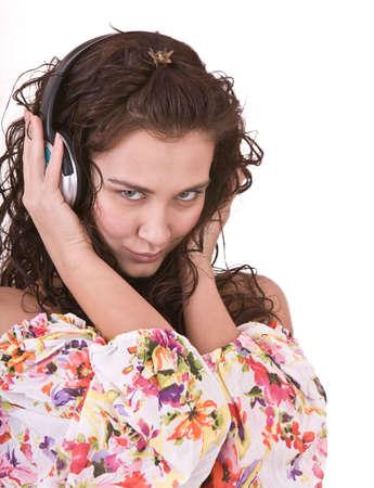 Girl in summer dress listen music. Isolated. photo