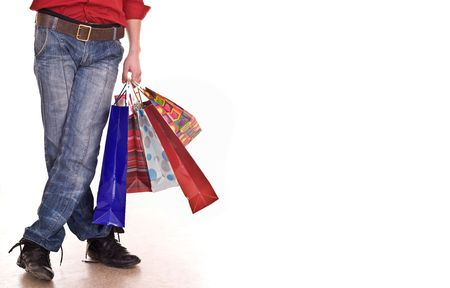 Male legs in blue jeans. Holiday shopping. Stock Photo - 4878965