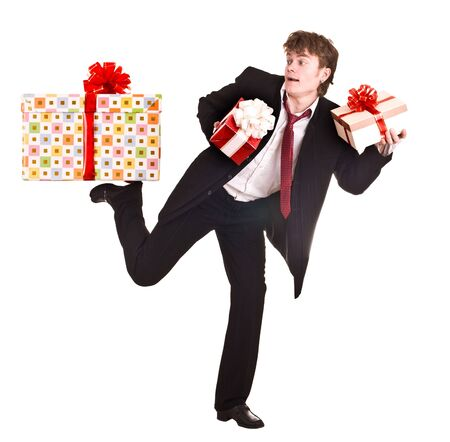 Man with falling gift box run. Isolated. Stock Photo - 4893317