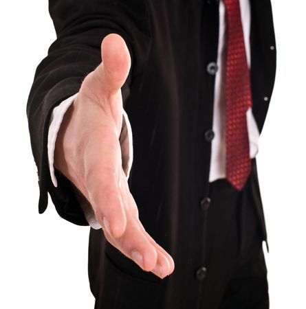 Businessman with greeting outstretched  hand. Isolated.