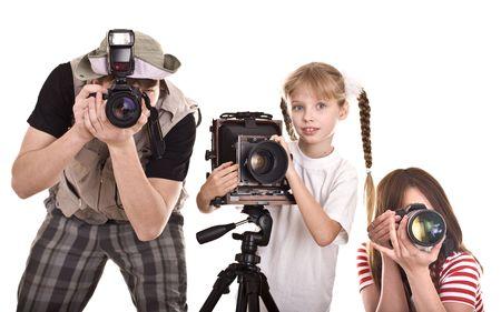 tress: Happy family with three camera. Isolated. Stock Photo