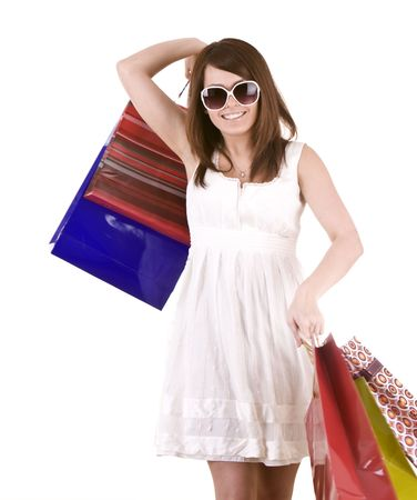Girl in glasses with gift bag shopping. Isolated. Stock Photo - 5554302