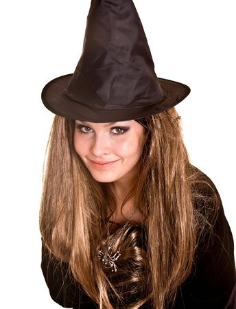 Happy witch in black dress and hat and spider.Isolated. photo