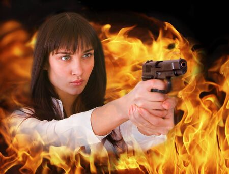 shoots: Aggressive girl shoots from flame. Collage.