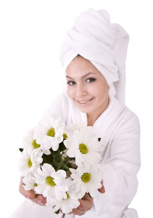 Girl with camomile and white towel on head .Isolated. photo