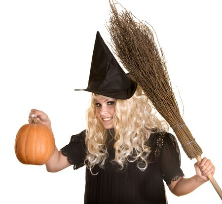 Halloween witch blond in black hat and dress with pumpkin on broom.Isolated. photo