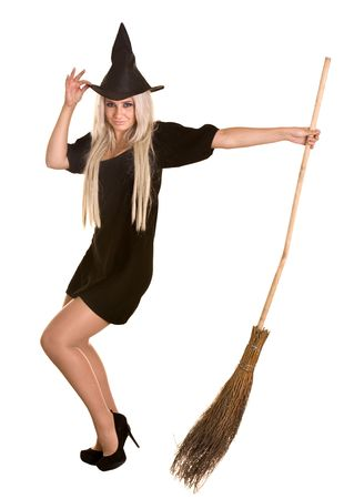 Halloween witch blond in black dress and hat with broom.Isolated. Stock Photo - 5595637