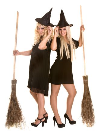 Two halloween witch blond in black dress and hat on broom.Isolated. photo