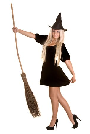 Halloween witch blond in black dress and hat with broom.Isolated. photo