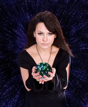 Girl with fortune telling ball against star sky.Illustration.