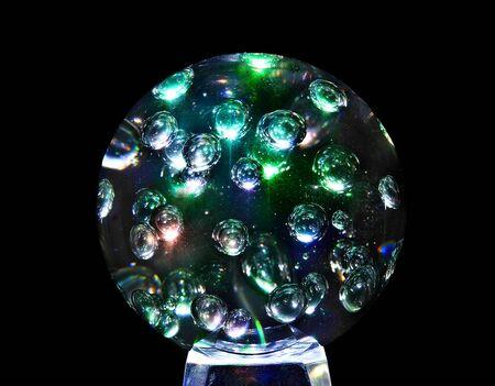 Mystic magic glass sphere ball. Isolated black background. Stock Photo - 5605668