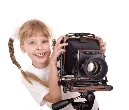 the format: Child  with old wood large format digital camera. Isolated.