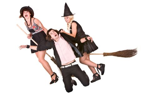 helpless: Group of girl witch on broom  bear helpless man. Isolated.