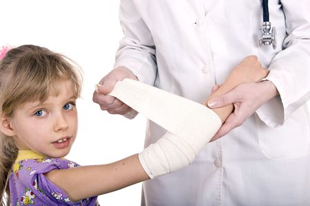 Doctor give first aid of child. Isolated. photo
