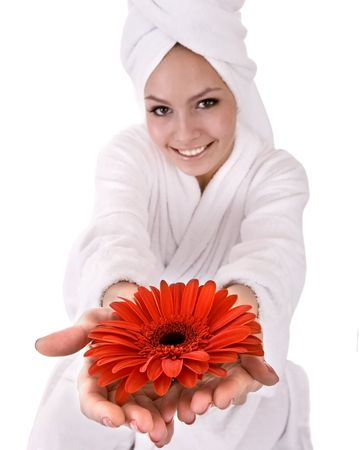 Girl with red flower and white towel on head .Isolated. photo